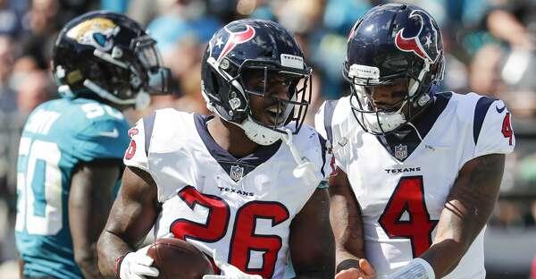 Houston Texans Running Back Lamar Miller (26) And Quarterback Deshaun  Watson (4) Celebrate Milleru0027s 5 Yard Touchdown Run Against The Jacksonville  Jaguars ...