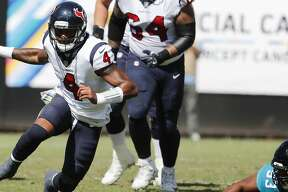 Houston Texans quarterback Deshaun Watson (4) breaks away from Jacksonville Jaguars defensive end Calais Campbell (93) during the second quarter of an NFL football game at TIAA Bank Field on Sunday, Oct. 21, 2018, in Jacksonville.