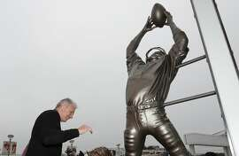 "Former San Francisco 49ers quarterback Joe Montana stands next to a statue of wide receiver Dwight Clark commemorating ""The Catch,"" which was unveiled along with a statue of himself, before an NFL football game between the 49ers and the Los Angeles Rams in Santa Clara, Calif., Sunday, Oct. 21, 2018. Clark caught a touchdown pass, known as ""The Catch,"" from Montana in the NFC Championship game to beat the Dallas Cowboys on Jan. 10, 1982. (AP Photo/Tony Avelar)"