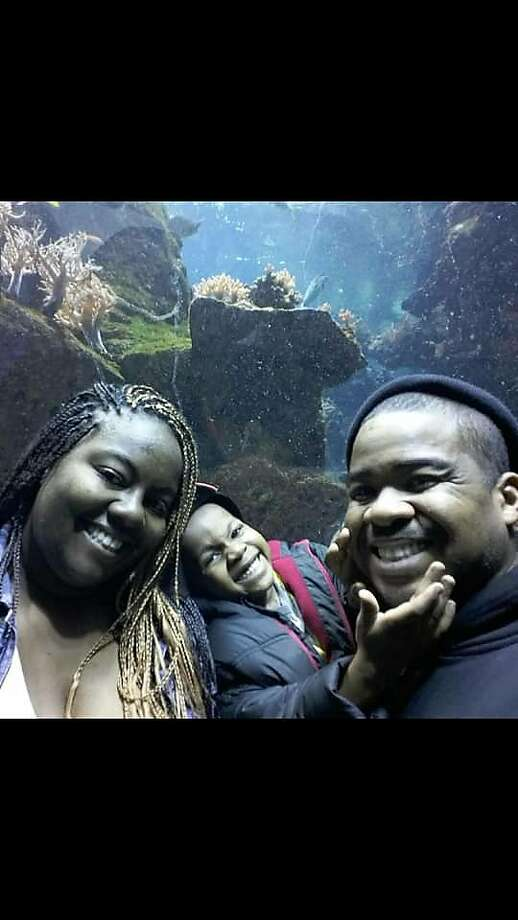 Michael Watkins (right), who was killed by a hit-and-run driver while walking Sunday in Pittsburg, is shown with his wife, Antinette, and son, Michael Jr. Photo: Courtesy Watkins Family