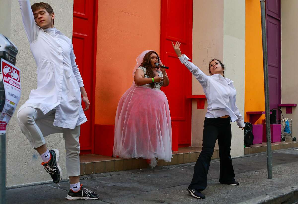 (l-r) Steamroller Dance company performers Arion Holtan, Maria Melinda David ,and Jocelyn Reyes perform on Natoma Street during the San Francisco Trolley Dances event in San Francisco, California, on Sunday, Oct. 21, 2018.