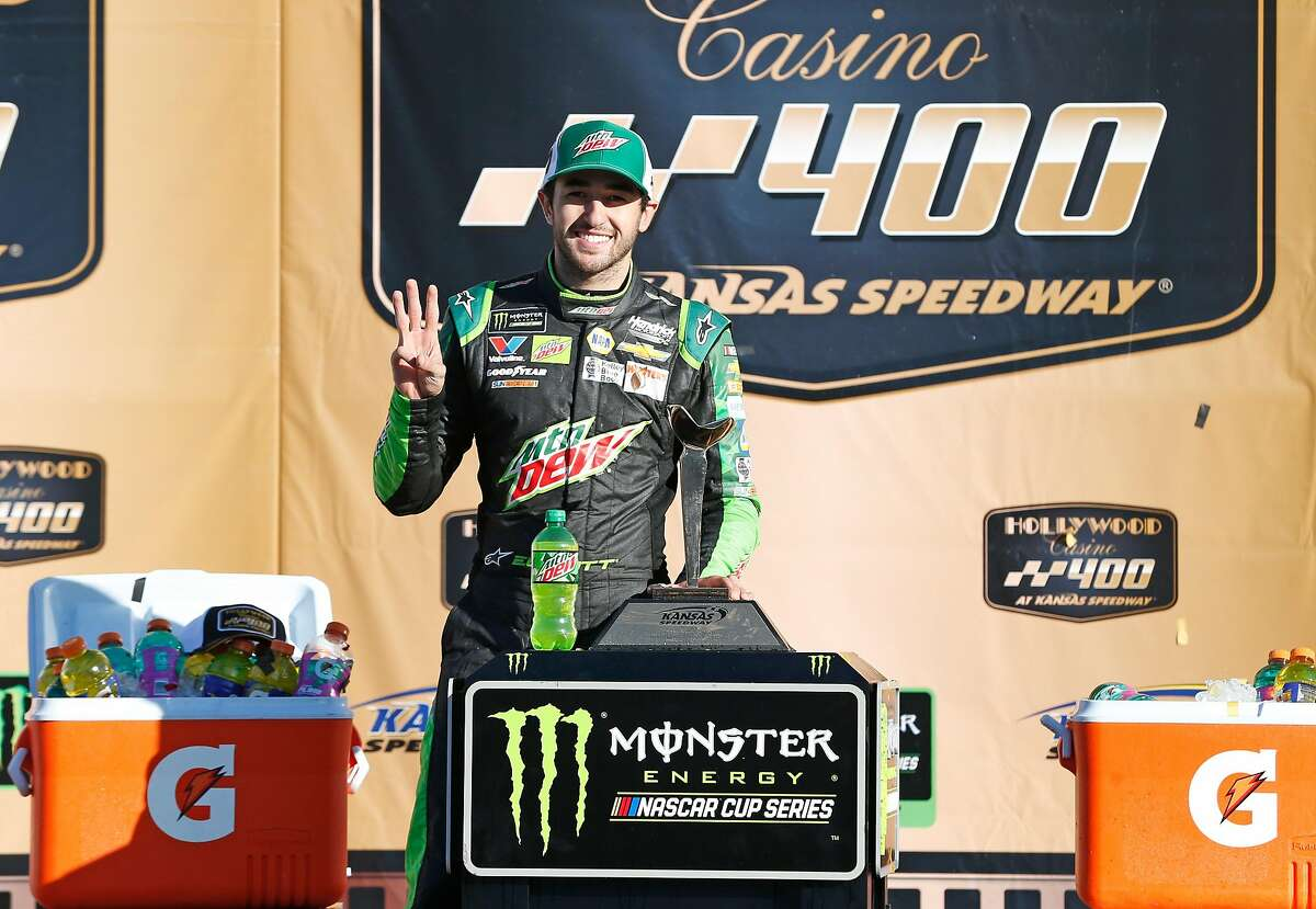 KANSAS CITY, KS - OCTOBER 21: Chase Elliott, driver of the #9 Mountain Dew Chevrolet, poses with the trophy after winning the Monster Energy NASCAR Cup Series Hollywood Casino 400 at Kansas Speedway on October 21, 2018 in Kansas City, Kansas. (Photo by Brian Lawdermilk/Getty Images)