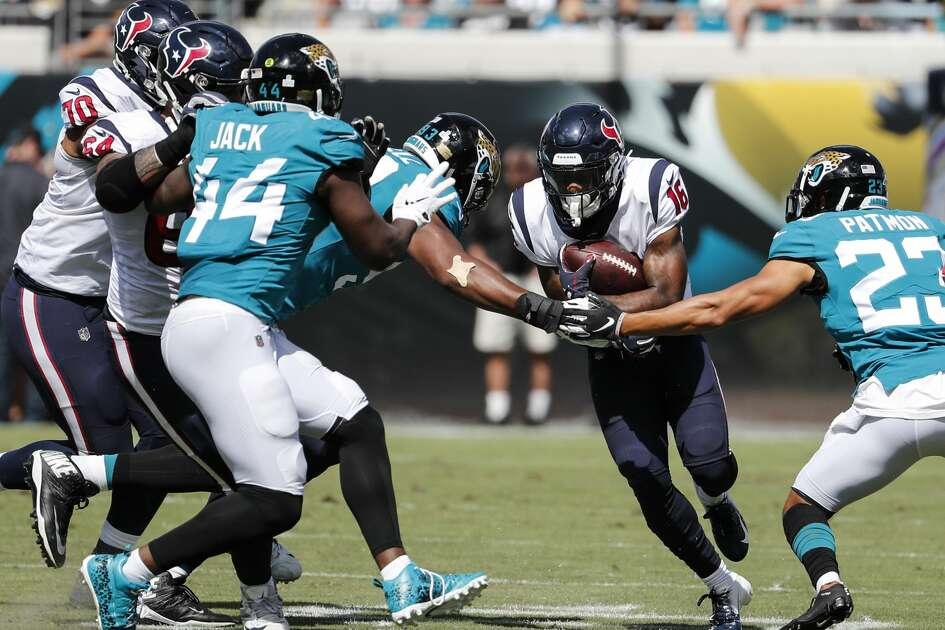 Houston Texans wide receiver Keke Coutee (16) makes a catch against the Jacksonville Jaguars defense during the second quarter of an NFL football game at TIAA Bank Field on Sunday, Oct. 21, 2018, in Jacksonville.