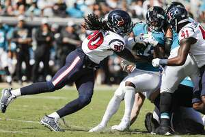Houston Texans linebacker Jadeveon Clowney (90) stops Jacksonville Jaguars running back T.J. Yeldon (24) behind the line of scrimmage during the second quarter of an NFL football game at TIAA Bank Field on Sunday, Oct. 21, 2018, in Jacksonville.