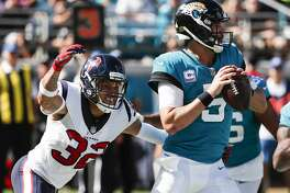 Houston Texans free safety Tyrann Mathieu (32) pressures Jacksonville Jaguars quarterback Blake Bortles (5) as he drops back to pass during the third quarter of an NFL football game at TIAA Bank Field on Sunday, Oct. 21, 2018, in Jacksonville.