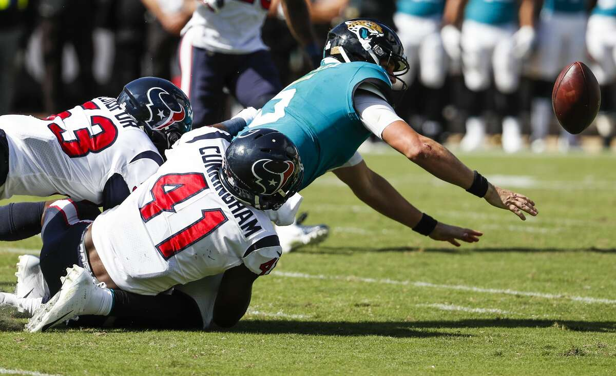 Houston Texans linebackers Zach Cunningham (41) and Duke Ejiofor (53) hit Jacksonville Jaguars quarterback Blake Bortles (5) forcing a fumble and a turnover during the third quarter of an NFL football game at TIAA Bank Field on Sunday, Oct. 21, 2018, in Jacksonville.