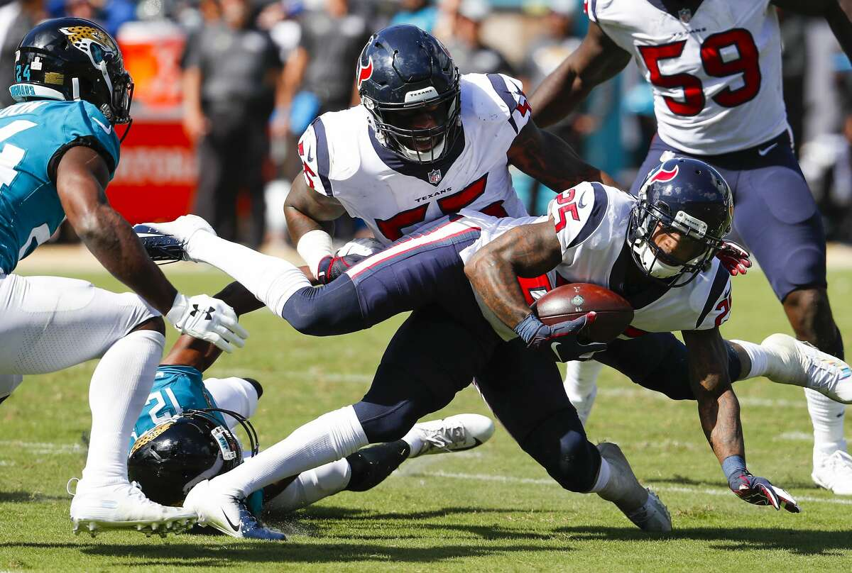 Houston Texans strong safety Kareem Jackson (25) picks up a fumble by Jacksonville Jaguars quarterback Blake Bortles (5) for a turnover during the third quarter of an NFL football game at TIAA Bank Field on Sunday, Oct. 21, 2018, in Jacksonville.