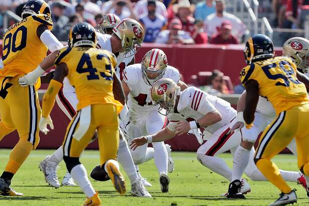 C. J. Beathard (3) lunges for a fumbled snap in the second quarter as the San Francisco 49ers played the Los Angeles Rams at Levi's Stadium in Santa Clara, Calif., on Sunday, October 21, 2018.