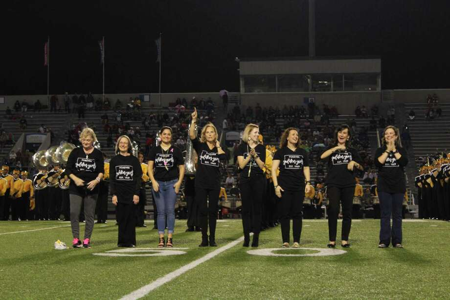 With a big smile and few laughs, the original director of the Conroe High School Golden Girls performed the Tiger Boogie among 99 alumnae in a special halftime performance that marked 50 years of celebrations. Photo: Meagan Ellsworth / Meagan Ellsworth