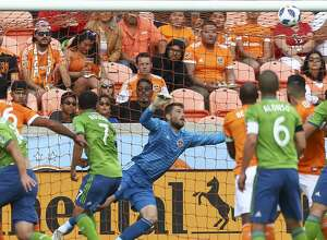 Seattle Sounders defender Chad Marshall (14) scores on a header off a corner kick during the first half of the MLS match against the Houston Dynamo at BBVA Compass Stadium Sunday, Oct. 21, 2018, in Houston.
