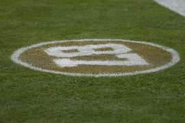 The number of former San Francisco 49ers wide receiver Dwight Clark is shown on the field before an NFL football game between the 49ers and the Los Angeles Rams in Santa Clara, Calif., Sunday, Oct. 21, 2018. (AP Photo/Tony Avelar)