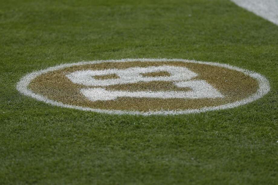 The number of former San Francisco 49ers wide receiver Dwight Clark is shown on the field before an NFL football game between the 49ers and the Los Angeles Rams in Santa Clara, Calif., Sunday, Oct. 21, 2018. (AP Photo/Tony Avelar) Photo: Tony Avelar / Associated Press