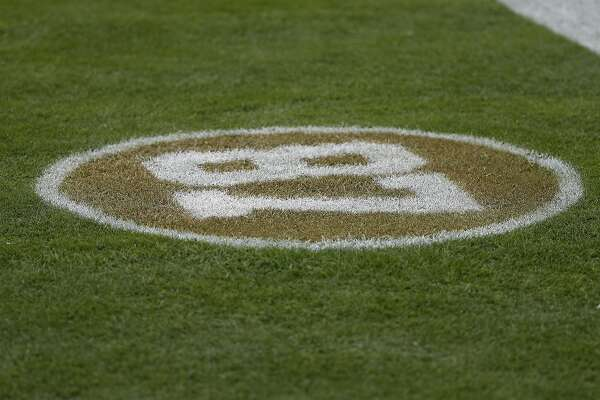 a18d9545f 1of35The number of former San Francisco 49ers wide receiver Dwight Clark is  shown on the field before an NFL football game between the 49ers and the  Los ...