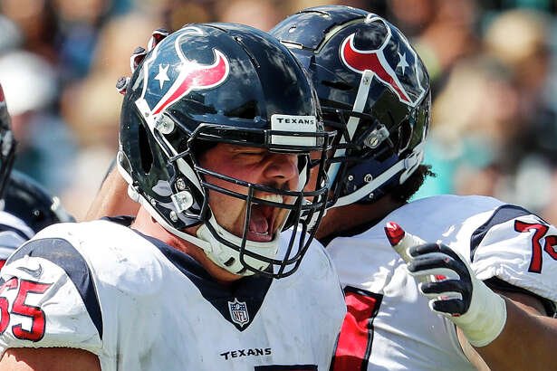 Houston Texans center Greg Mancz (65) celebrates Lamar Miller's 5-yard touchdown run against the Jacksonville Jaguars during the second quarter of an NFL football game at TIAA Bank Field on Sunday, Oct. 21, 2018, in Jacksonville.