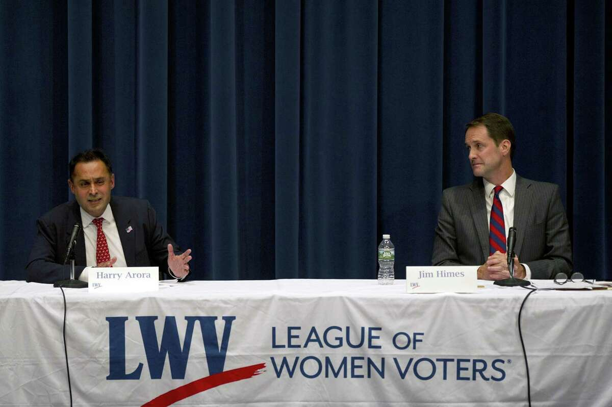 Republican challenger Harry Arora, left, debates Democratic incumbent Jim Himes during the League of Women Voters 4th Congressional District Debate inside the Clune Permforming Arts Center at Wilton High School on Sunday.