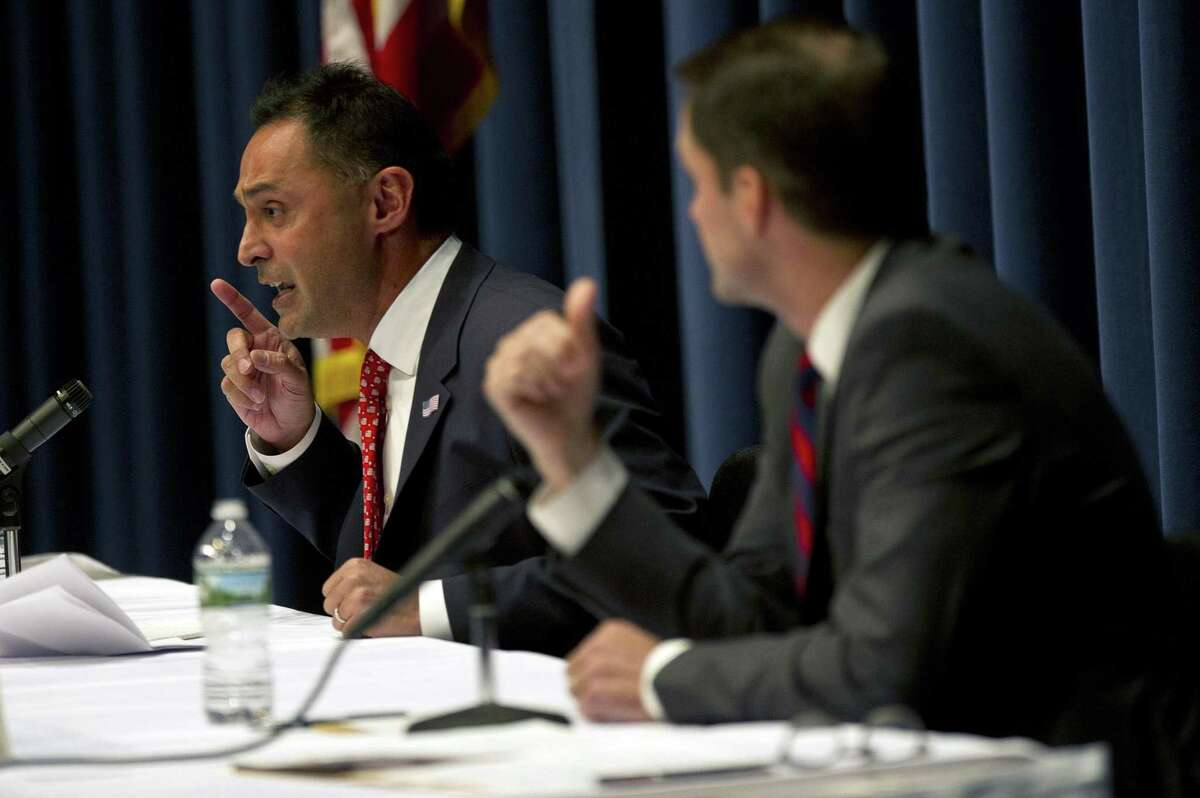 Republican challenger Harry Arora, left, debates Democratic incumbent Jim Himes during the League of Women Voters 4th Congressional District Debate at Wilton High School on Sunday.