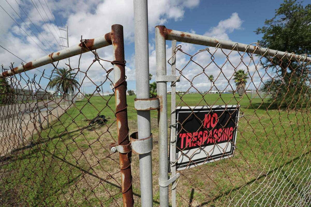 A fenced in field is all that is left of the Oleander Homes 5228 Broadway Wednesday, Oct. 3, 2018, in Galveston.