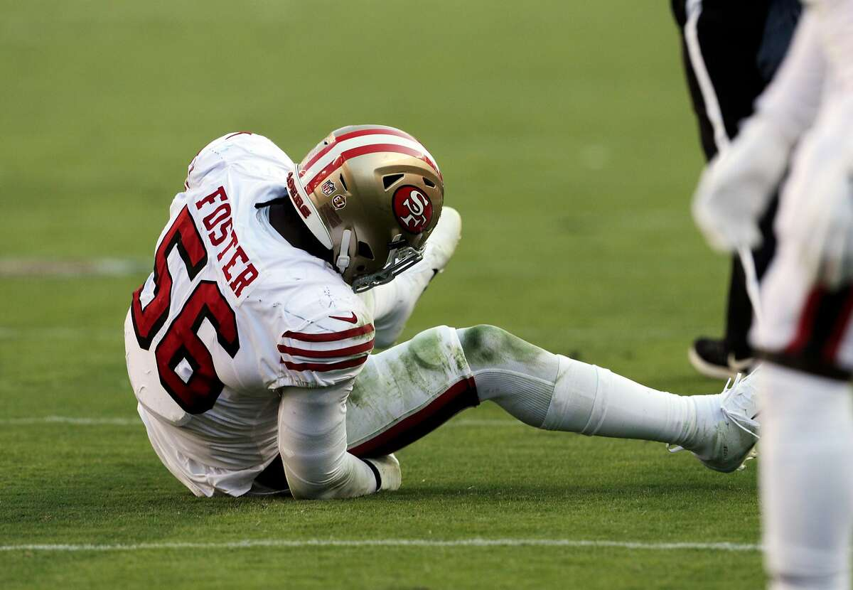 Reuben Foster (56) rolls on the turf after an injury in the fourth quarter as the San Francisco 49ers played the Los Angeles Rams at Levi's Stadium in Santa Clara, Calif., on Sunday, October 21, 2018.