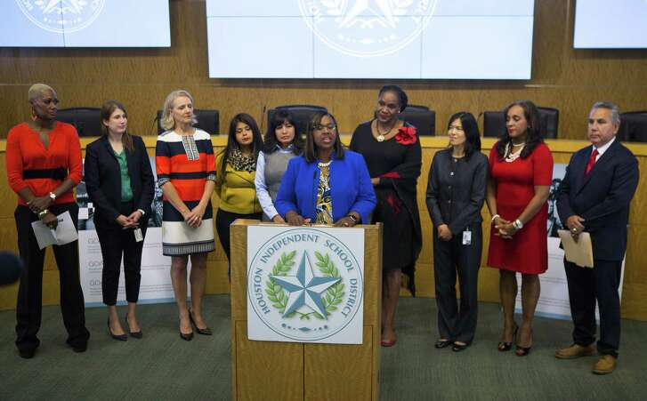 Houston ISD trustees apologized for turmoil caused when they briefly ousted Interim Superintendent Grenita Lathan, at the podium.