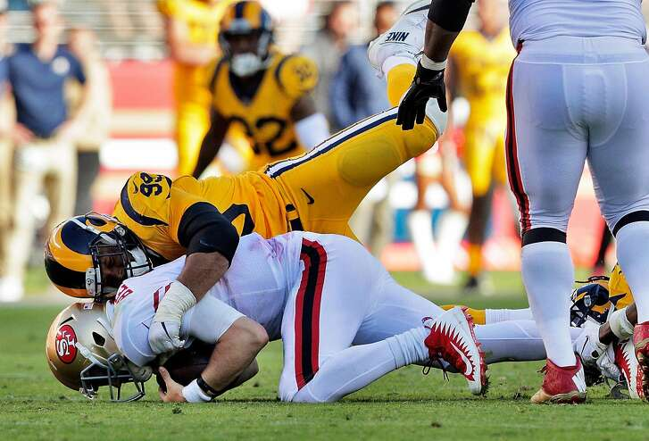C. J. Beathard (3) is sacked by Aaron Donald (99) in the fourth quarter as the San Francisco 49ers played the Los Angeles Rams at Levi's Stadium in Santa Clara, Calif., on Sunday, October 21, 2018.