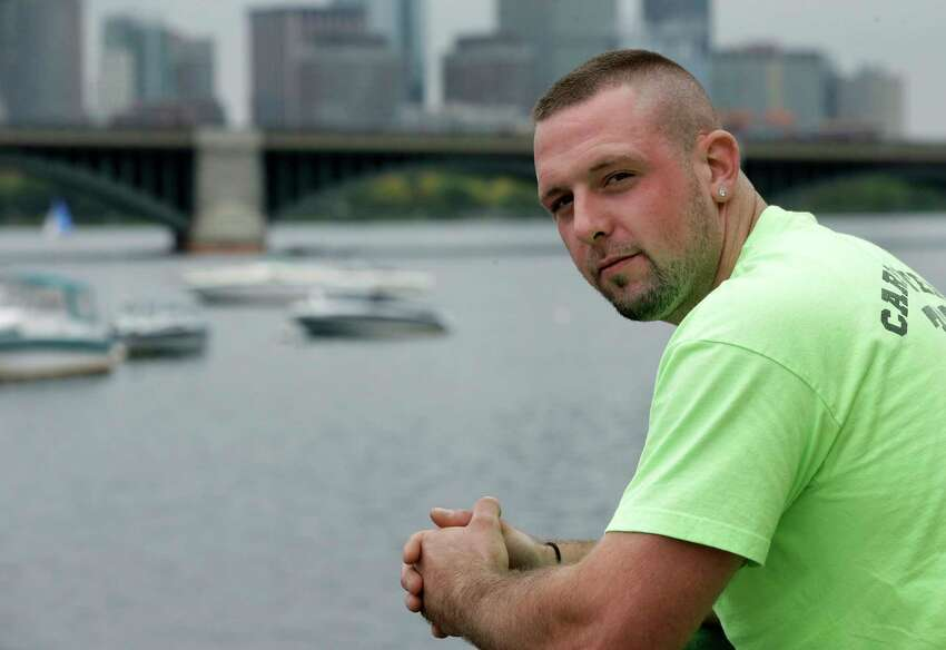 In this Monday, Oct. 1, 2018 photo Michael Robinson, of North Reading, Mass., in recovery from heroin addiction, stands for a photo near the Charles River, in Cambridge, Mass. Robinson recently became a union carpenter and has been working on building projects across the Boston area since. In Massachusetts, with Medicaid expansion already paying for opioid addiction treatment, emergency money from Congress goes largely toward recovery services. (AP Photo/Steven Senne)