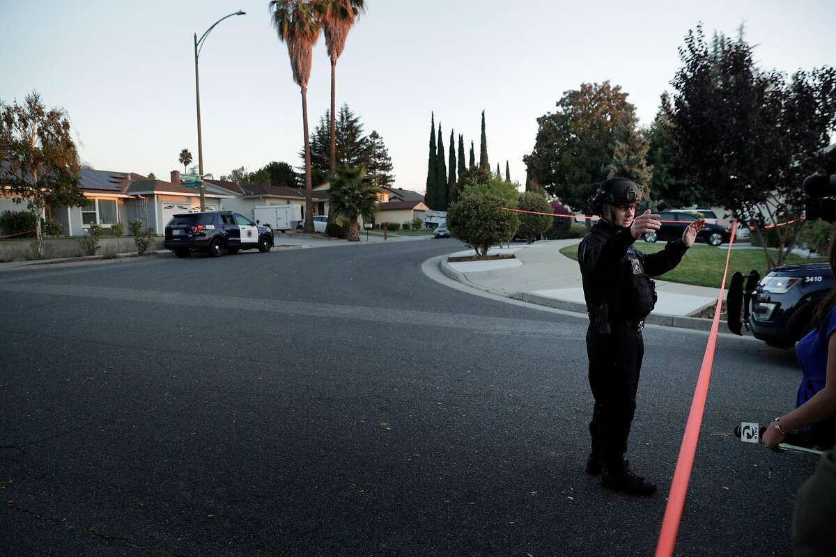 San Jose Police tend to leftover fireworks after two men were injured in an accidental detonation in the garage of a home on Moonflower Court in San Jose, Calif., on Sunday, October 21, 2018.