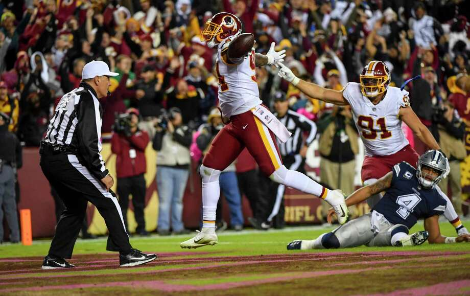 a134f9eaeaf Washington Redskins linebacker Preston Smith (94) runs a fumble recovery  into the end zone