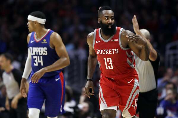 Houston Rockets' James Harden (13) gestures after making a 3-point basket against the Los Angeles Clippers during the first half of an NBA basketball game Sunday, Oct. 21, 2018, in Los Angeles. (AP Photo/Marcio Jose Sanchez)