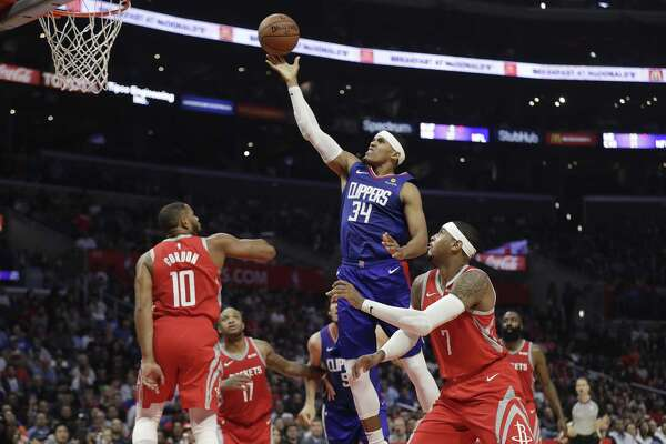 Clippers forward Tobias Harris drives to the basket against the Rockets during the first half Sunday in Los Angeles. Harris scored 23 points to lead the Clippers.