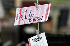 A sign displays the $1.6 billion prize for Tuesday's Mega Millions lottery drawing at the Stewart's Shop's location on Frontage Road on Sunday, Oct. 21, 2018, in Glenmont, N.Y. (Will Waldron/Times Union)