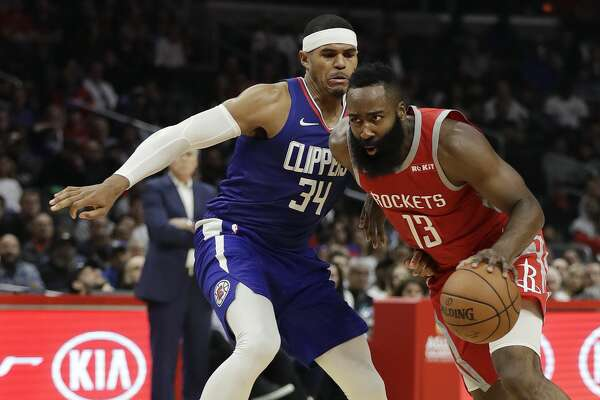Houston Rockets' James Harden (13) dribbles past Los Angeles Clippers' Tobias Harris (34) during the second half of an NBA basketball game Sunday, Oct. 21, 2018, in Los Angeles. The Clippers won, 115-112. (AP Photo/Marcio Jose Sanchez)