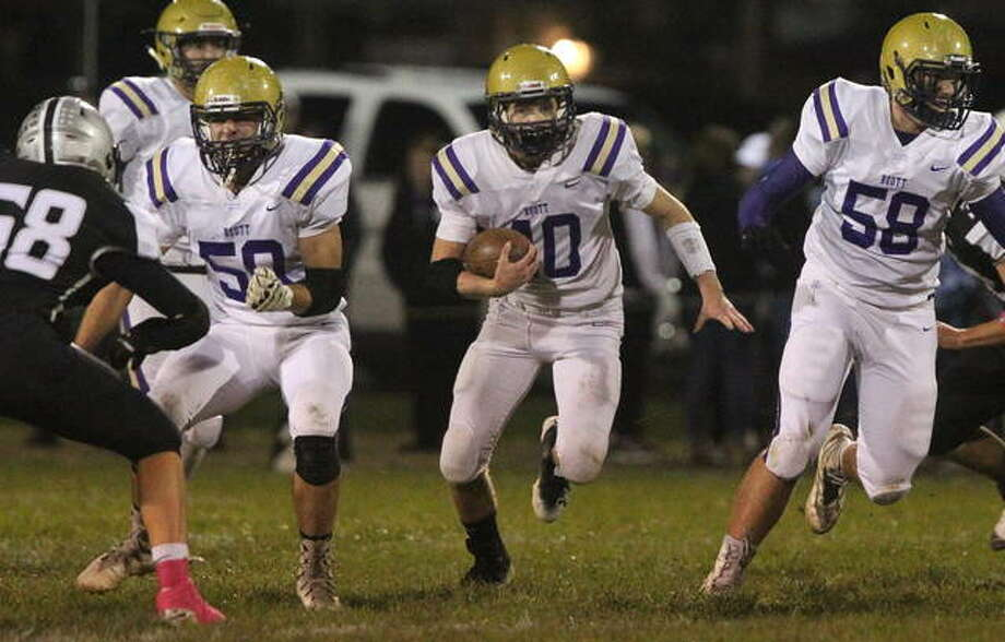 Routt's Lucas May (left) and Cade Bilbruck open a hole for running back Dylan Marshall during a high school football game against West Central in Winchester last Friday night.