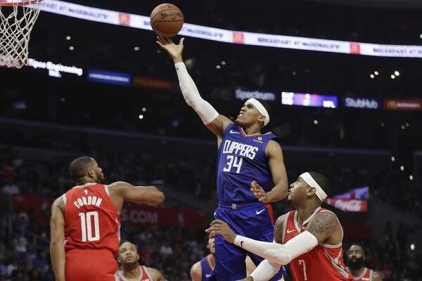 Los Angeles Clippers' Tobias Harris (34) drives to the basket against the Houston Rockets during the first half of an NBA basketball game Sunday, Oct. 21, 2018, in Los Angeles. (AP Photo/Marcio Jose Sanchez)
