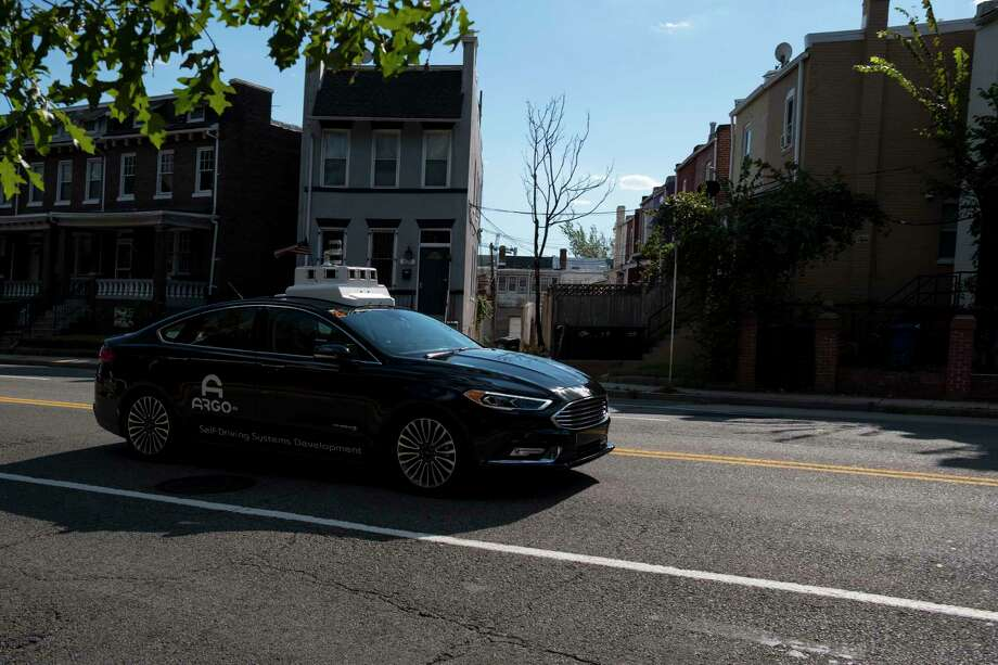 A Ford Fusion hybrid goes for a spin in Northeast Washington last week. The mapping specialists from Argo AI, a self-driving start-up that Ford is backing with a $1 billion investment, drove the vehicle in manual mode. Photo: Washington Post Photo By Calla Kessler / The Washington Post