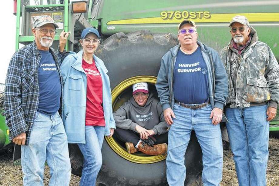 Hunter Sauer and Theresa Sauer, the parents of Jenny Sauer, along with family friend Danny Berry and uncle Scott Anderson show the latest shirts from The Witty Farmer. Photo: Nick Draper | Journal-Courier