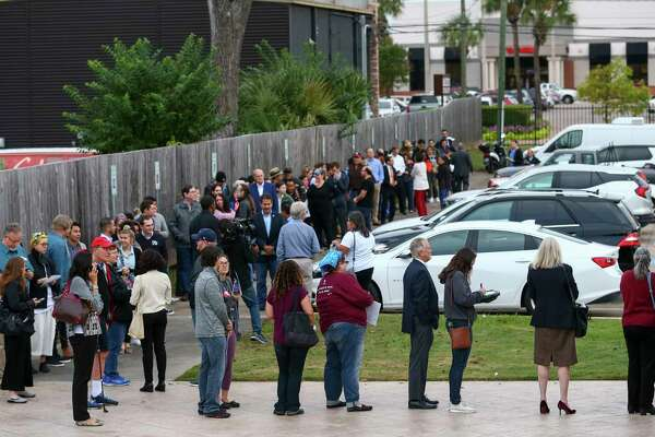 People wait in line for early voting at the Metropolitan Multi-Services Center on West Gray Street Monday, Oct. 22, 2018, in Houston.