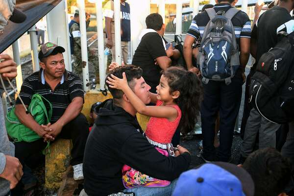 A Honduran migrant and his daughter, who are taking part in a caravan heading to the US, rest as they wait to cross the border from Ciudad Tecun Uman in Guatemala, to Ciudad Hidalgo, Mexico, on October 22, 2018. - President Donald Trump on Monday called the migrant caravan heading toward the US-Mexico border a national emergency, saying he has alerted the US border patrol and military. (Photo by ORLANDO SIERRA / AFP)ORLANDO SIERRA/AFP/Getty Images