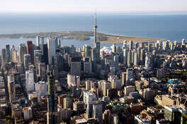 The CN Tower stands among buildings in the downtown skyline in of Toronto on Oct. 2, 2017.