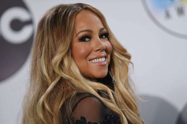 US singer Mariah Carey poses in the press room at the 2018 American Music Awards on October 9, 2018, in Los Angeles, California. (Photo by Valerie MACON / AFP)VALERIE MACON/AFP/Getty Images