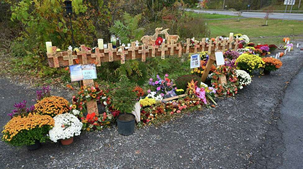 A makeshift memorial is made at the site of the limousine accident that took the lives of 20 people on Monday, Oct. 22, 2018, in Schoharie, N.Y. (Skip Dickstein/Times Union)