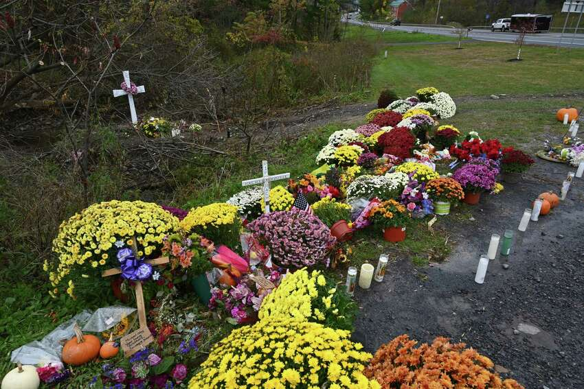 The makeshift memorial is made at the site of the limousine accident that took the lives of 20 people on Monday, Oct. 22, 2018, in Schoharie, N.Y. (Skip Dickstein/Times Union)