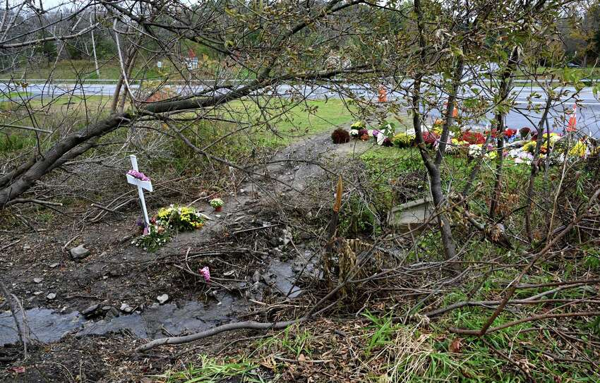 A cross marks the final resting point of the limo at the site of the accident that took the lives of 20 people on Monday, Oct. 22, 2018, in Schoharie, N.Y. (Skip Dickstein/Times Union)