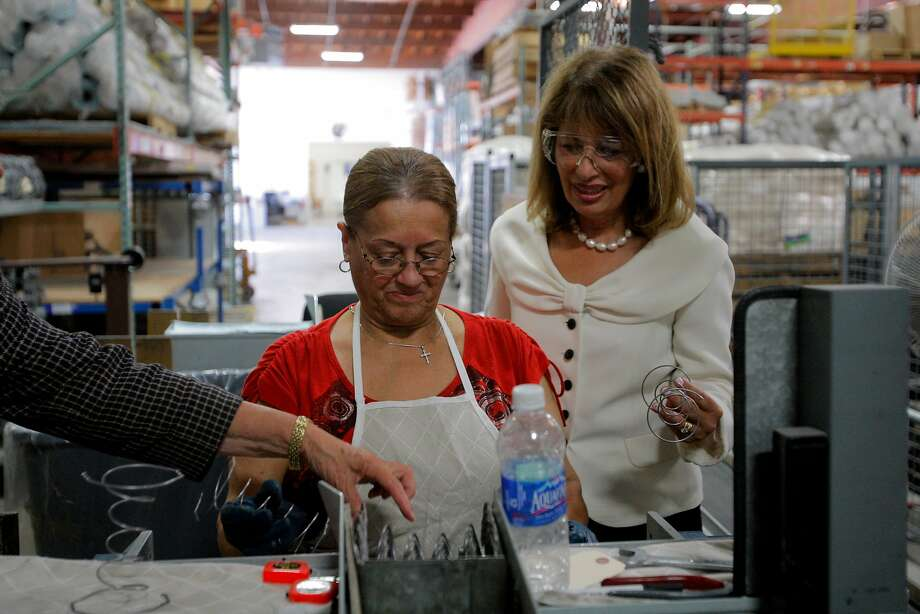 Lucy Ortiz (left) and Congresswoman Jackie Speier are seen at the McRoskey factory in 2012. Photo: Megan Farmer / The Chronicle 2012