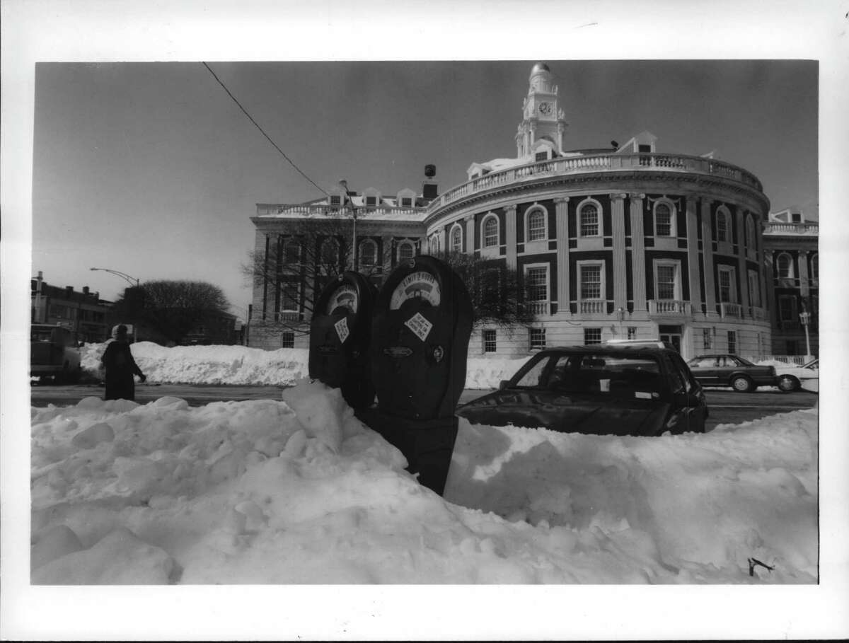 2. March 13-14, 1993 Snowfall: 26.6 inches Almost completely buried in snow, these parking meters near Schenectady City Hall showing time left, indicate that Schenectady motorists would rather wade thru snowdrifts than face parking tickets.
