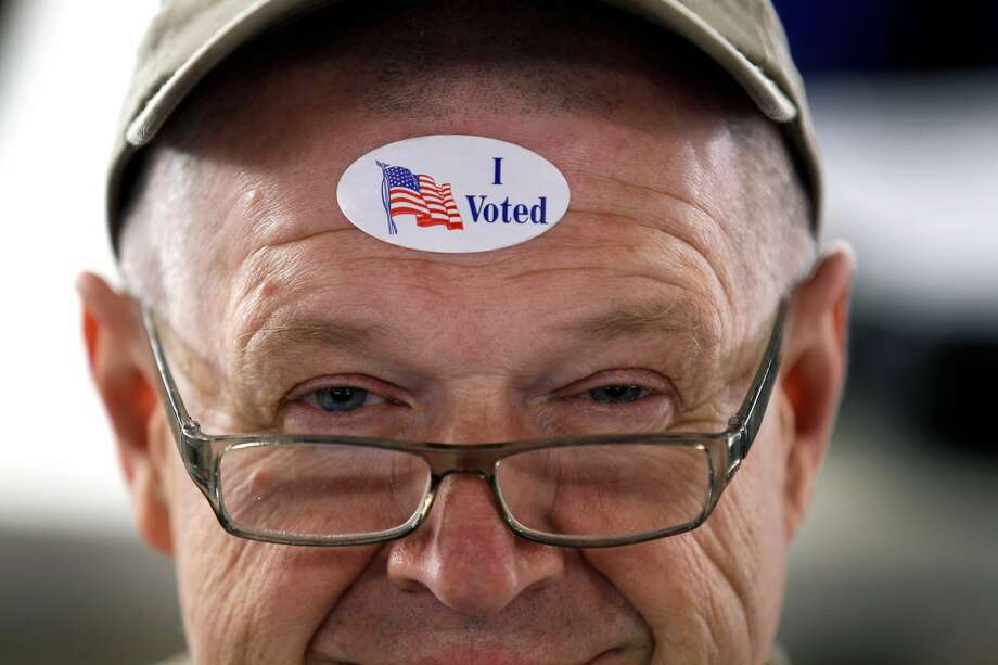 "PHOTOS: Early voting in Houston  Chances are if you go to the polls you will be leaving with a special ""I Voted"" sticker somewhere on your body. The mundane sticker was become a source of pride for many.   >>>See how early voting went in Houston...  Photo: Joe Raedle/Getty Images"