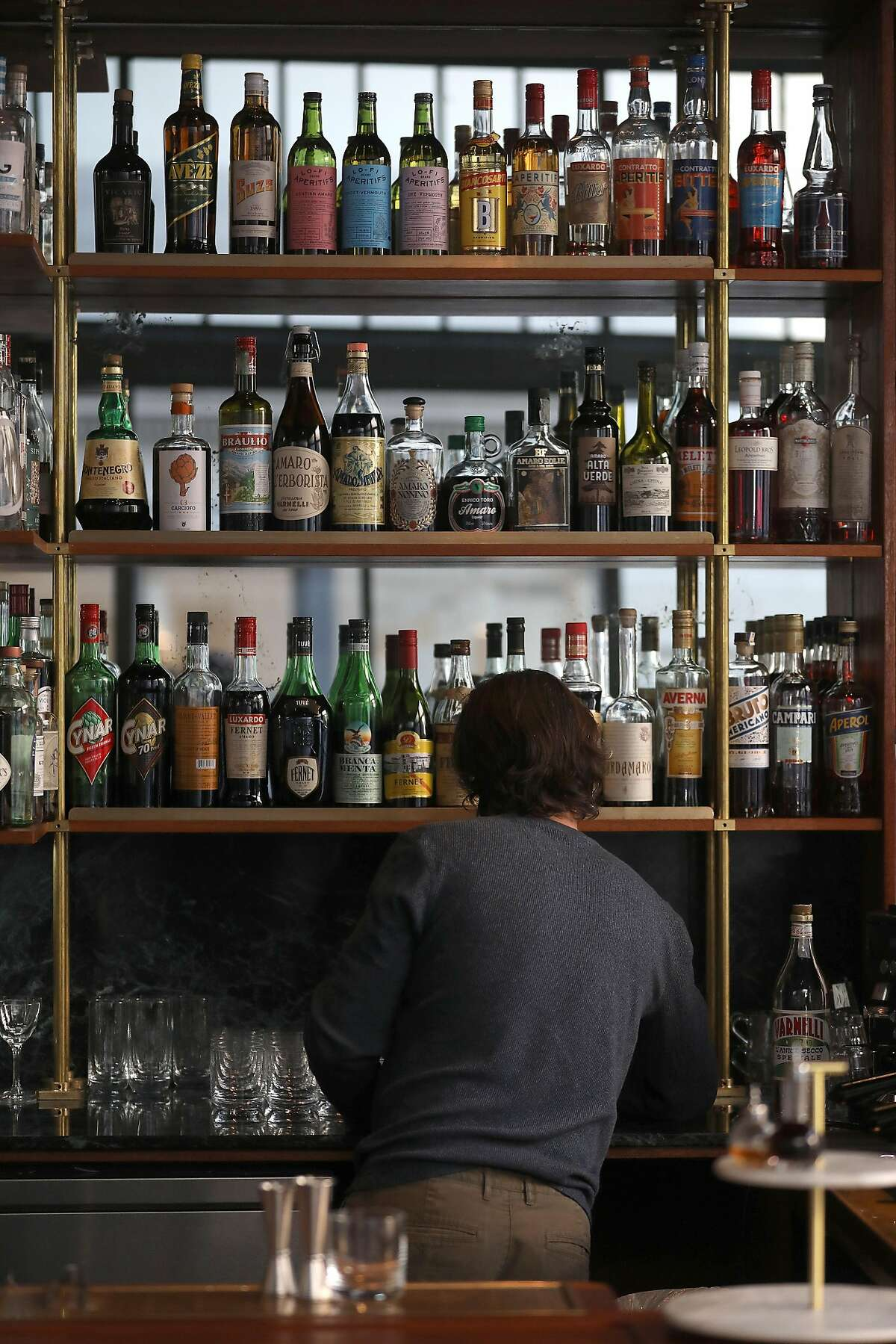 on Wednesday, Oct. 17, 2018 in San Francisco, Calif. This is for a Drink Up review of the Cordial. Please shoot: -Exterior of bar, especially the windows -back bar the Lo-Fi amari (which they use pretty heavily) -Greg Lindgren & Jon Gasparini, owners -Thistle spritz (make sure they do the rosemary garnish) -Zucchero cocktail -Cardamom spritz -Action shots of patrons -Action shots of bartender making drinks -Anything else that looks interesting What's Happening at this time: