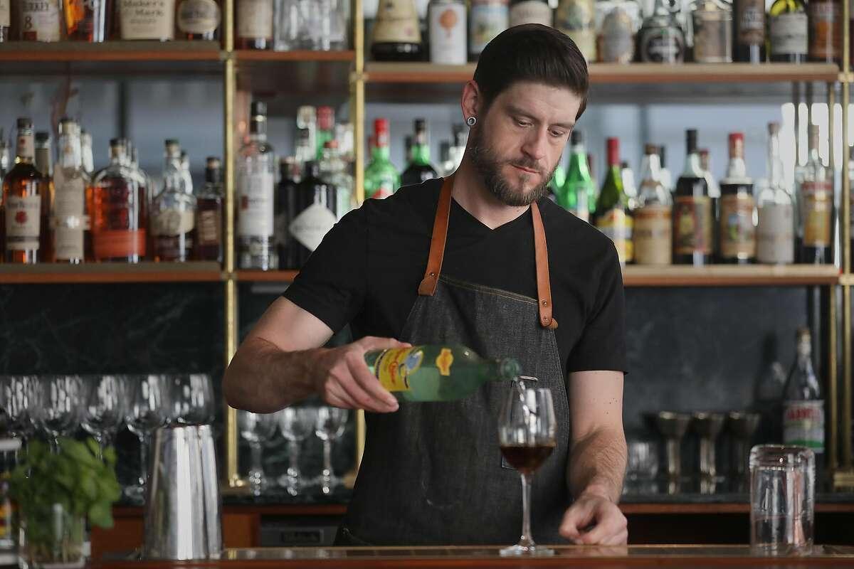 Bartender Ben Parlichek makes a spritz cocktail at the Cordial.