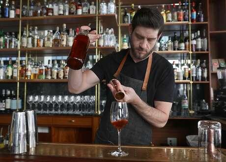 Bartender Ben Parlichek makes a Thistle spritz drink seen at Cordial bar on Wednesday, Oct. 17, 2018, in San Francisco, Calif.