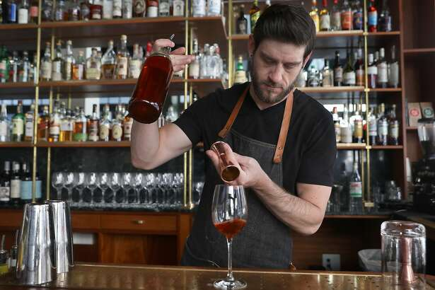 Bartender Ben Parlichek makes a Thistle spritz drink seen at Cordial bar on Wednesday, Oct. 17, 2018, in San Francisco, Calif.