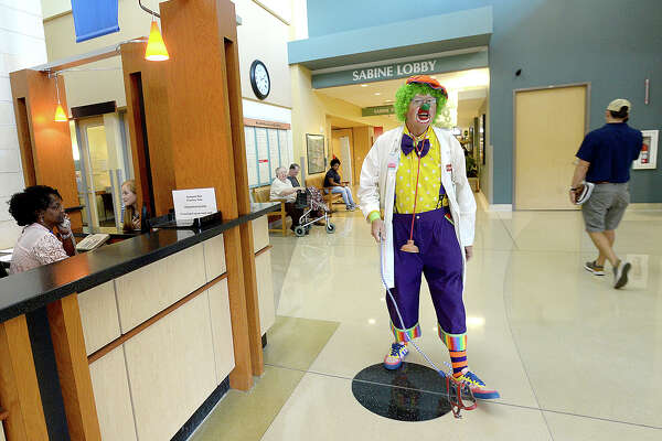 Larry Thompson, aka Dr. U. Getwell, makes his weekly rounds to patients and staff at Baptist Hospital in Beaumont. Thompson has been volunteering at the hospital since 2007, and calls his clown work a ministry, bringing a moment of joy to patients and families in what is often a difficult time. Friday, October 5, 2018 Kim Brent/The Enterprise